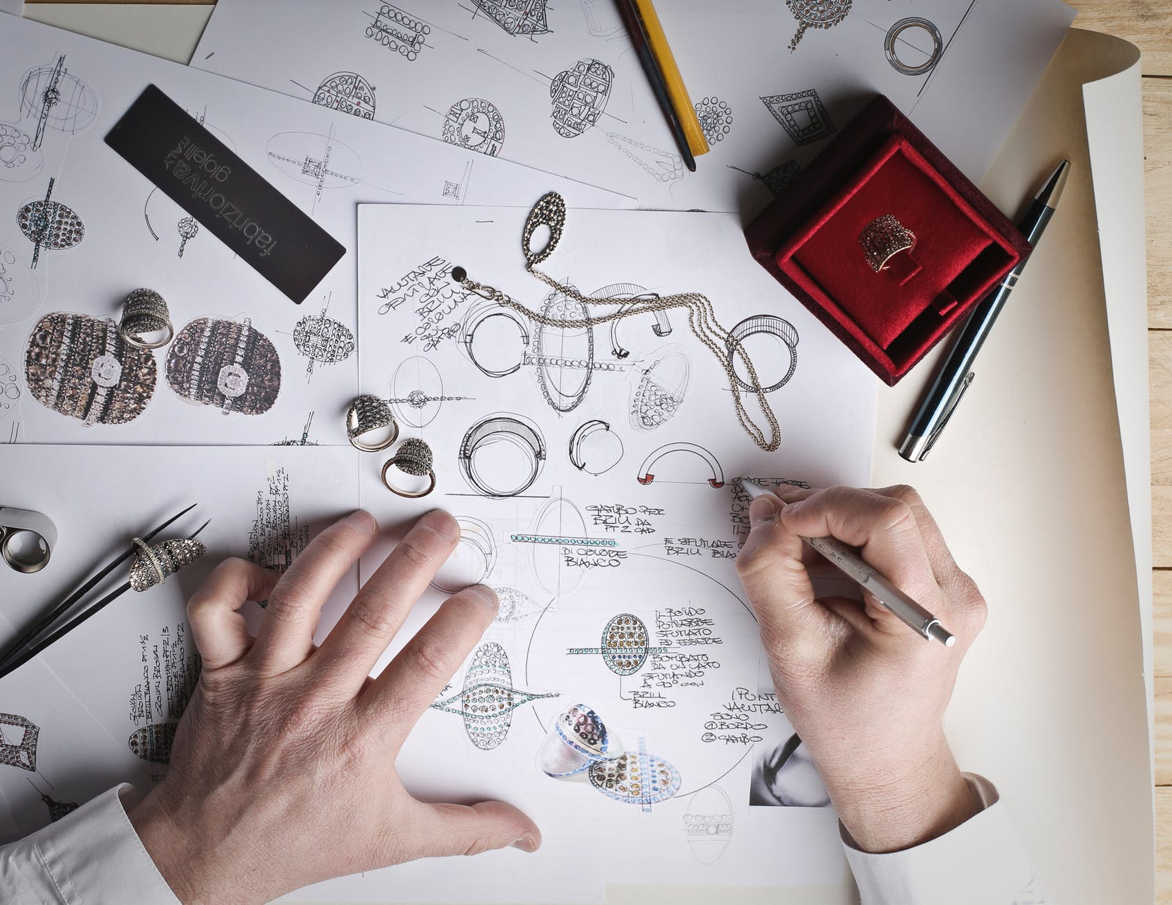 jewelry designer designs jewelries on paper